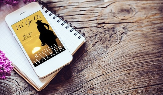 we go on book novel on iphone on wood background